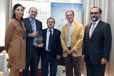 En el centro,los premiados Javier Briceño, César Hervás y Manuel de la Mata