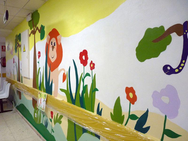 El mural del león casi terminado con una simpática serpiente morada
